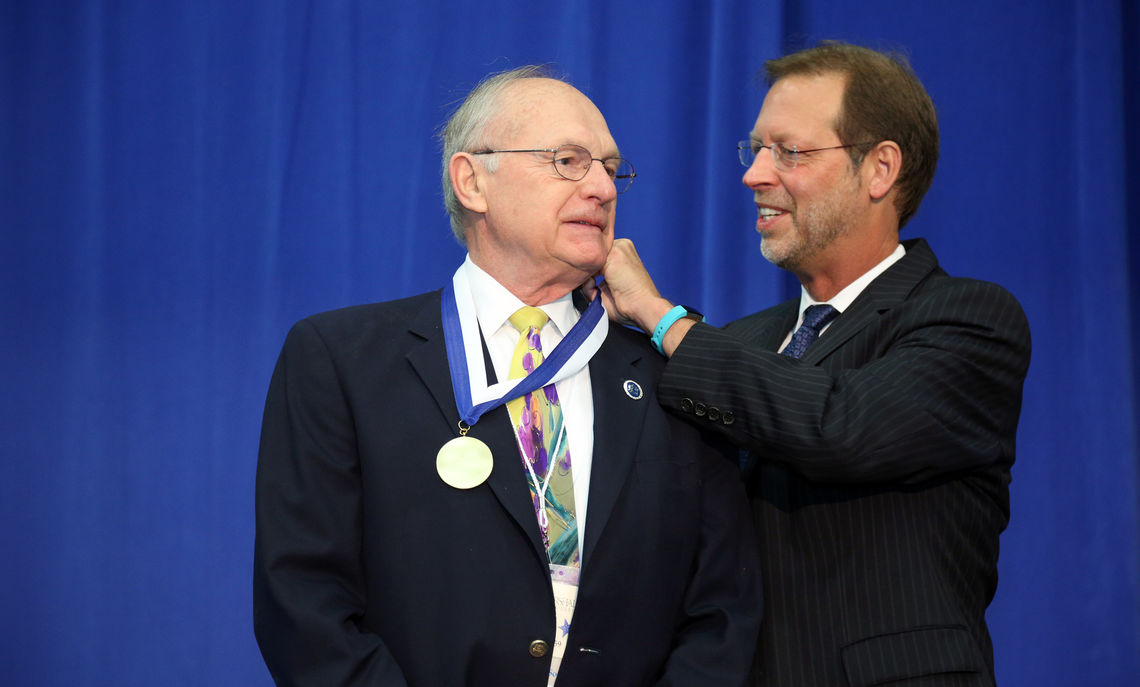 President Daniel R. Porterfield bestows the Nevonian Medal upon recipient James Hoeschele '59 for his distinguished career as a chemist.