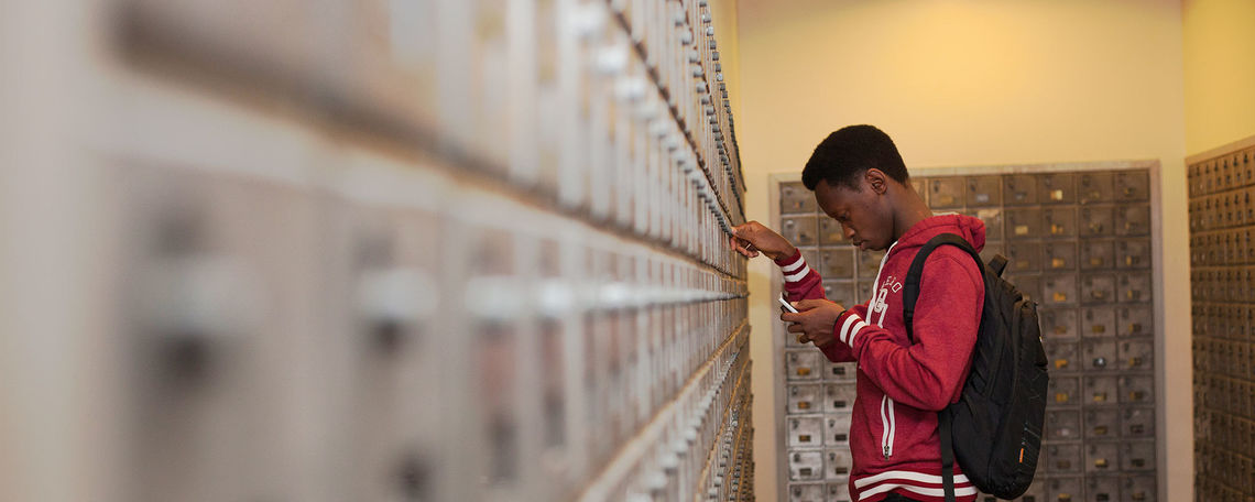 Student checking mail box