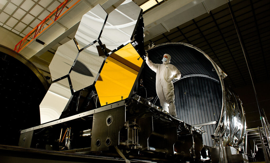 NASA engineers at work on the space telescope's mirror assembly.
