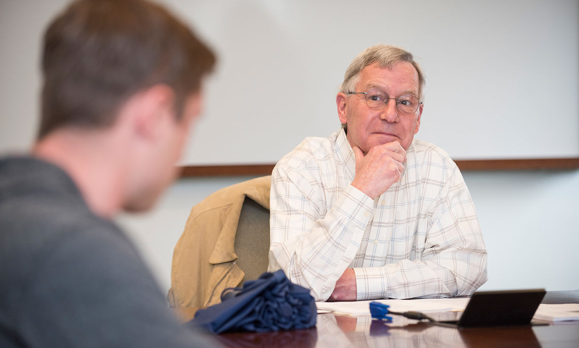"""Professor David Schuyler engages with a student in his seminar, """"Olmsted's America."""""""