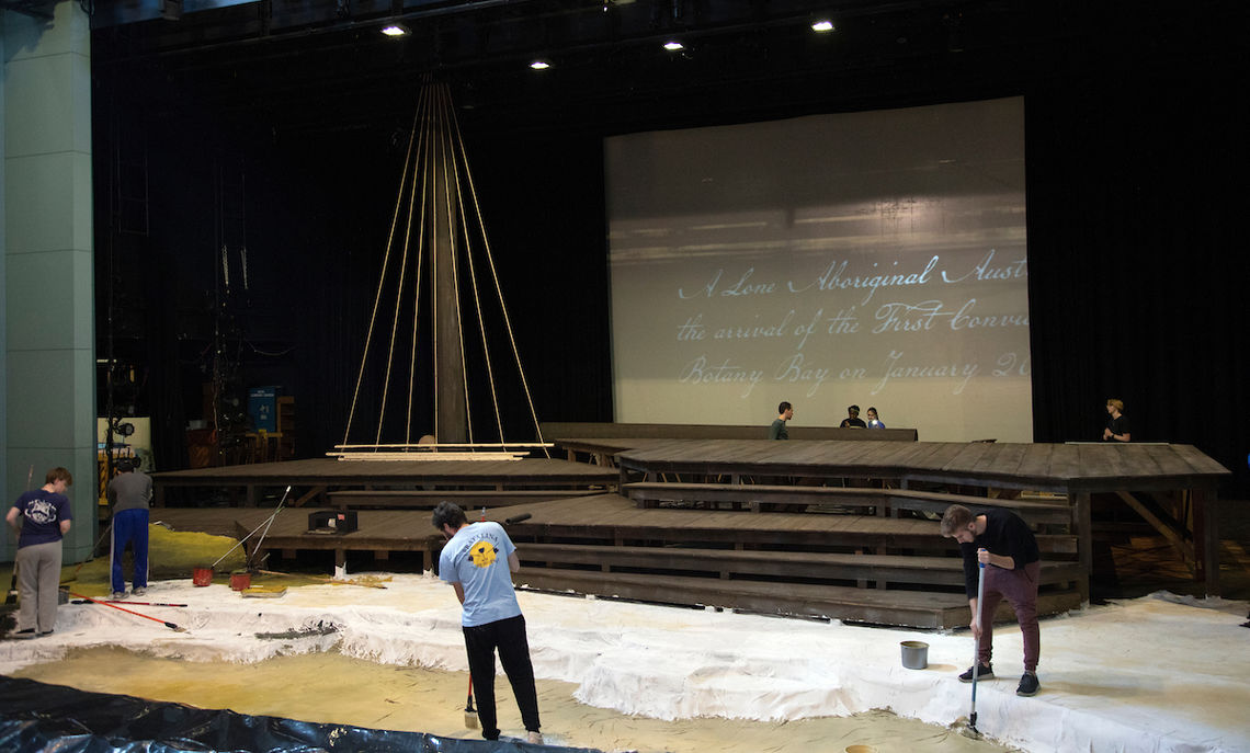 Completion of the set nears as the mast awaits the sail.