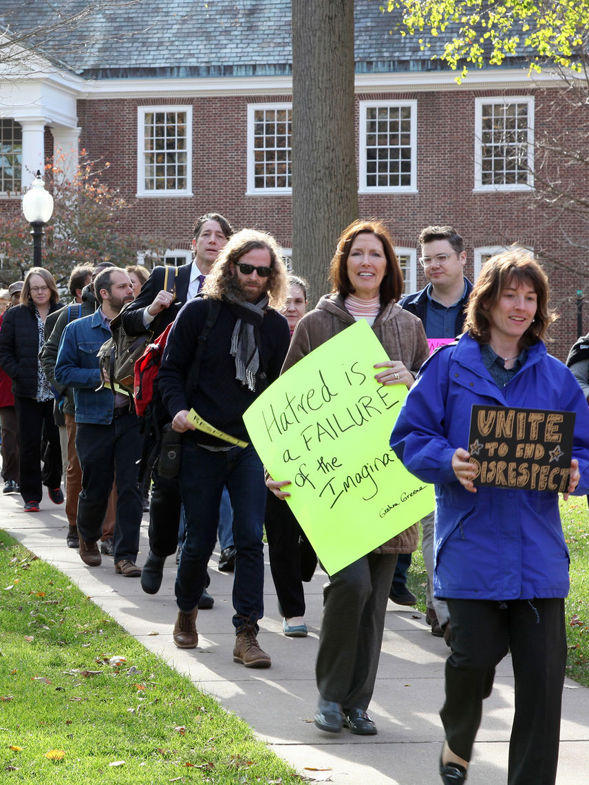 Members of the faculty and professional staff march from Shadek-Fackenthal Library to the Protest Tree to show their support for under-represented F&M students.