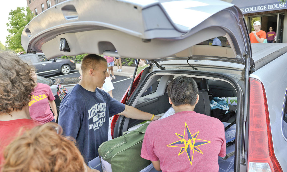 A band of upperclass students helps first-year students unpack their belongings on move-in day, Friday, Aug. 26.