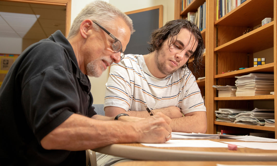 Prof. Wendell Ressler joins first-time Summer Hackman Scholar Nart Shalqini '21 in pondering a problem without a known answer, guiding the student to think about how to correctly frame his research question on algebraic number theory.
