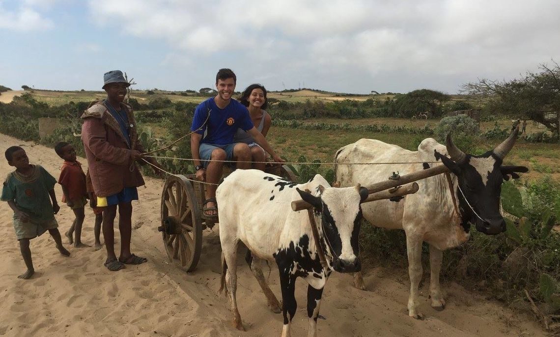 Story author Fullam did a semester abroad in Madagascar. Here he is riding in a charette in the village of Ekonka on the southern tip of Madagascar.