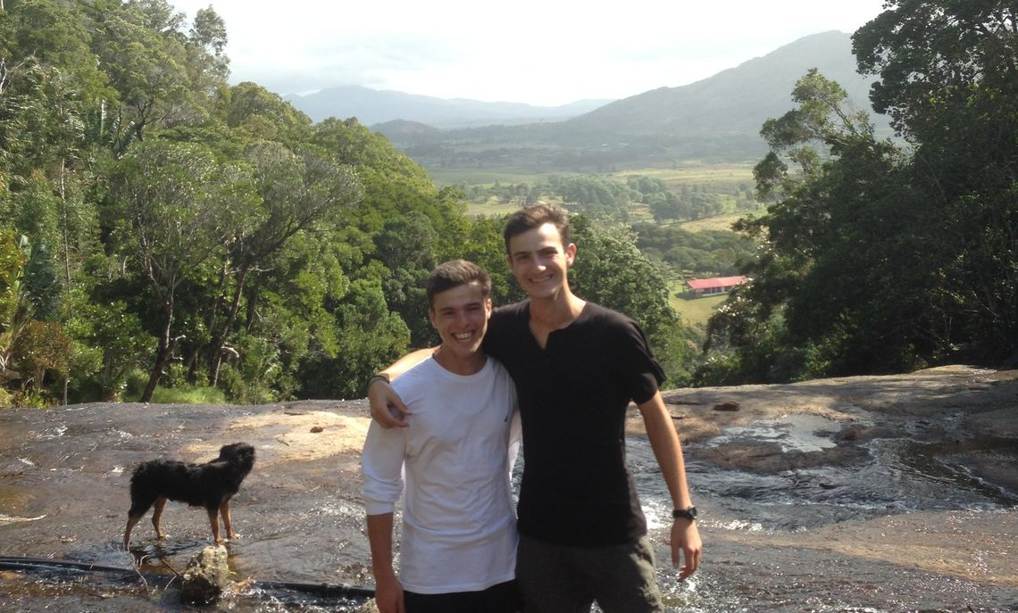 Fullam stands at the top of a waterfall with one of his classmates in Manantantely, Madagascar.