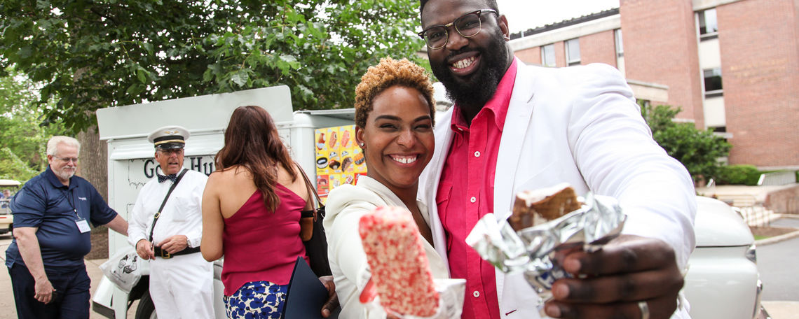 Ice cream from the Good Humor man makes Joaquim Hamilton '06 and his wife, Intisar '06, smile at the Reunion Barbecue.