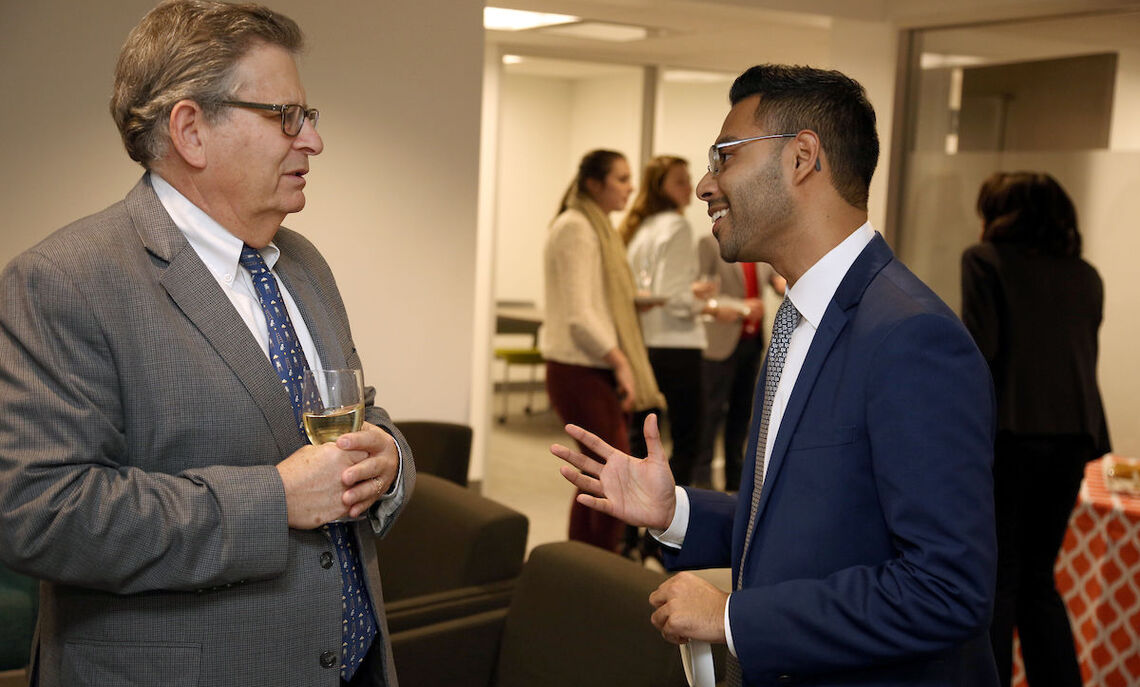 At a Feb. 10 reception for the opening  of Harwood Commons, Brett Harwood '71 talks with Akbar Hossain '13, a Truman Scholar who as a student was active in the Ware Institute for Civic Engagement.
