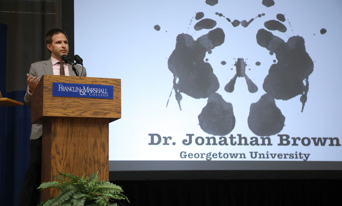 Dr. Jonathan Brown stood before a large audience in Franklin & Marshall College's Mayser Gym and presented a Rorschach test inkblot.