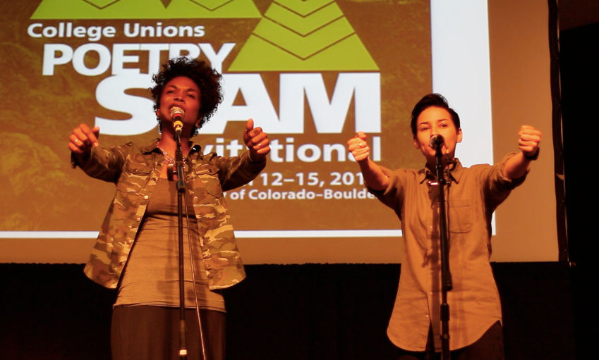 Dominique Christina, left, and Denice Frohman perform at the College Union Poetry Slam Invitational in Boulder, Colo., in 2014.