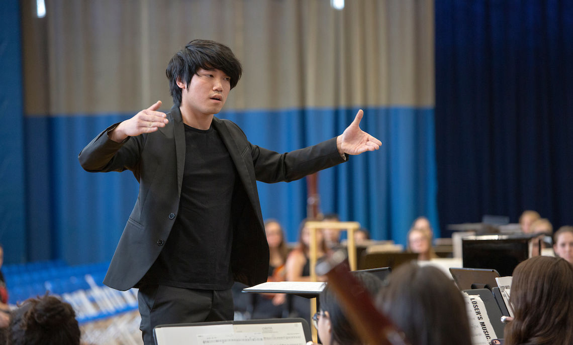 "First-year Yifeng Darin Xie conducts John Mackey's ""Sheltering Sky."""