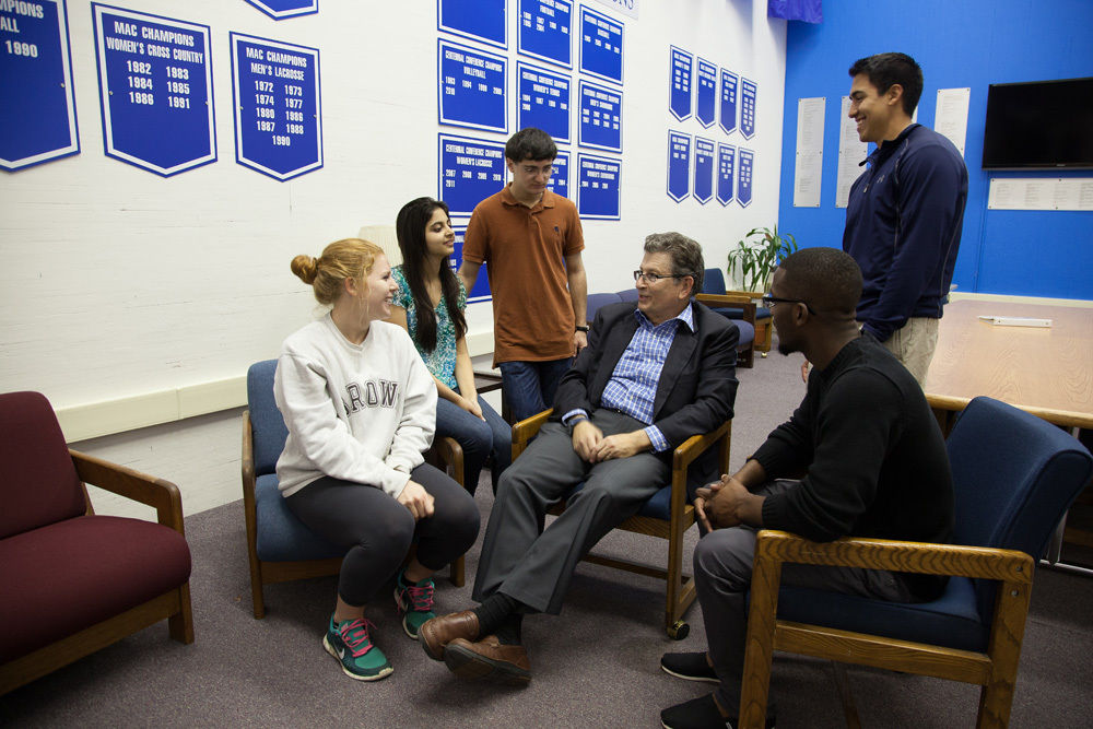 F&M Trustee Brett Harwood '71 meets students participating in the leadership seminar he created.