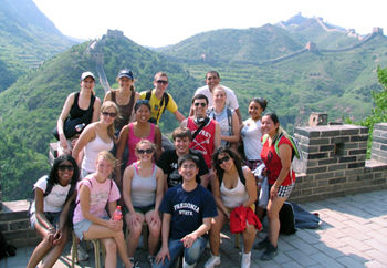 The 14 students who participated in the Chinese Life and Culture travel course this summer stop for a photograph at the Great Wall of China. Monica Cable (last row, second from the left), visiting assistant professor of anthropology, led the trip.