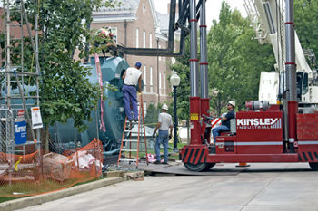 A work crew eases one of the College's new boilers into the Carolyn and Robert Wohlsen '50 Center for the Sustainable Environment.