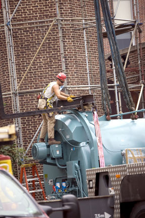 A worker prepares one of three 26.5-ton boilers for installation at the Wohlsen Center.