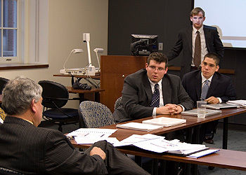 Dan Coffman '10 (standing) listens during a meeting between members of the Student-Managed Investment Portfolio and executives from Fulton Bank.