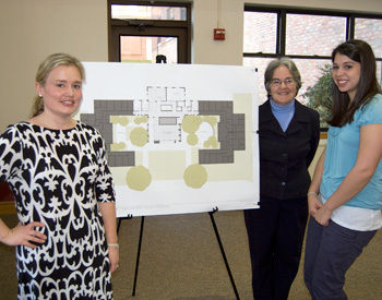 Members of the Schnader House community pose with plans for Weis College House (from left): Kate Snider '99, associate dean and house prefect; Kathleen Triman, professor of biology and house don; and Courtney Lutz '11, chair of the Schnader assembly of peers.