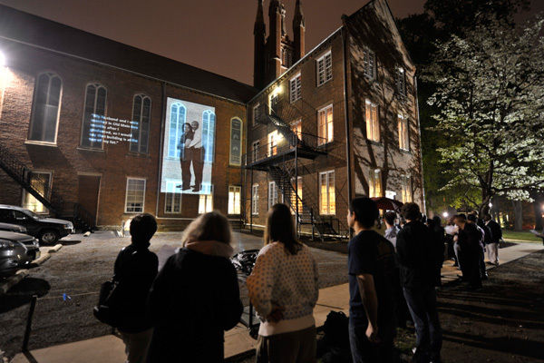 "An image of Monica Gantz DuBose '85 and Raymond C. DuBose '84 illuminates the south side of Nevin Chapel on Monday evening. The couple's image was part of ""Association, Memory and Time: Six Decades of the African-American Experience at F&M,"" a project by Tigist Hailu '11. The DuBoses were married in Old Main in 1985. (Photos by Eric Forberger)"