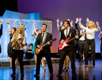 The Cast Of Wedding Singer Performs A Number During Dress Rehearsal On Jan 17 In Roschel Performing Arts Center Photos By Eric Forberger