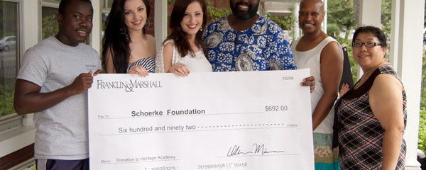 F&M's Gray Scholars raised funds to support the Heritage Academy in Ghana, a school founded by F&M alumnus Kwesi Koomson '97. Two Gray Scholars, Arlena Ombasic '14 and Sanela Ombasic '14, presented the gift to Koomson on May 29. Pictured at the check presentation are, from left, Emmanuel Arthur '15 (a graduate of the Heritage Academy and an F&M student), Arnela Ombasic, Sanela Ombasic, Koomson, F&M's Associate Dean for Multicultural Affairs Marion Coleman, and Assistant Director for Multicultural Affairs Xay ChongTua. (Photo by Tim Brixius)