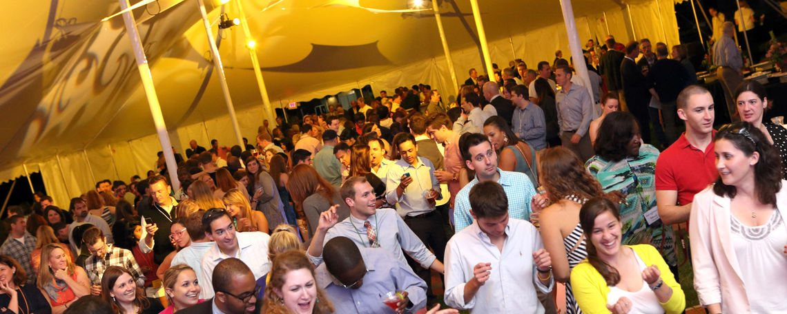 Franklin & Marshall College alumni dance to the sounds of the band Clockwork on Hartman Green during Reunion Weekend 2012's Party on the Green event June 2. (Photo by Nick Gould)