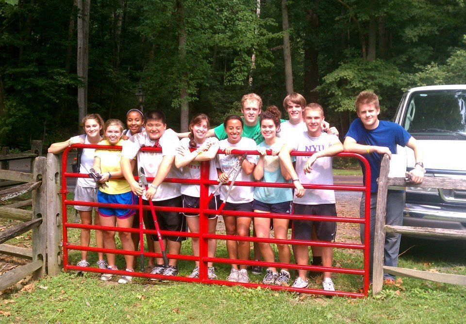F&M students gather after painting a fence at Millport as part of the Putting It Together in the Community program. (Photo courtesy of Mark Harmon-Vaught)