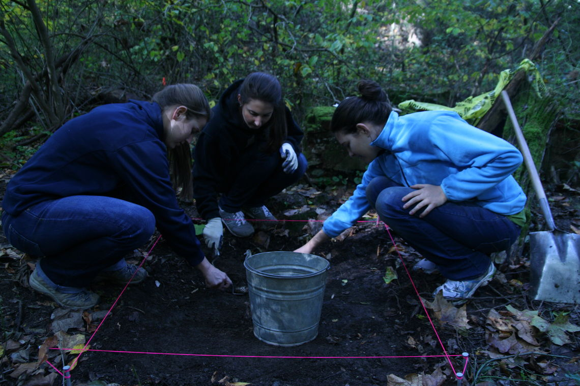 From left, Kelsey Baker '13, Misha Enayat '13 and Brittany Cole '13 work at the excavation site. (Photo courtesy of Scott Smith)