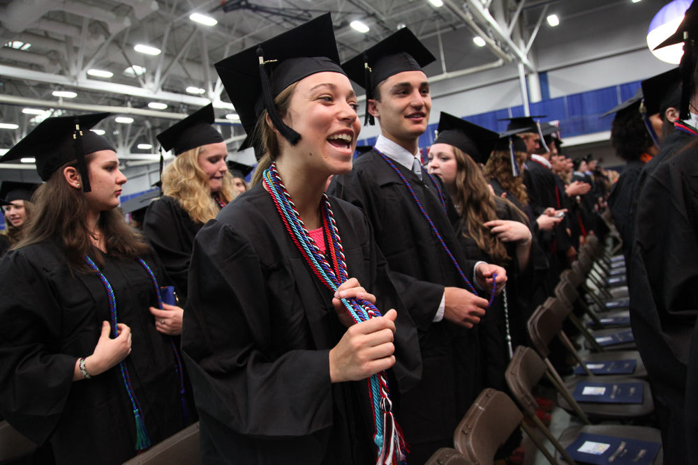 Members of the Class of 2013 smile in anticpitation of the kickoff of F&M's Commencement ceremony May 11 in the Alumni Sports & Fitness Center. Just under 600 students marched in the ceremony. (Photo by Melissa Hess)