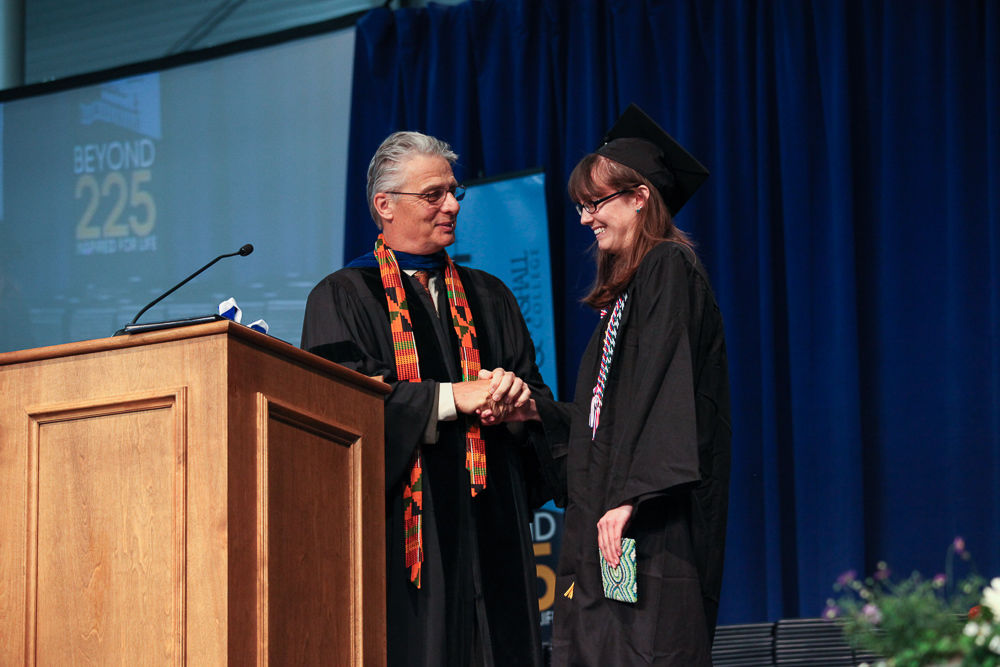 Dean of the College Kent Trachte presents the Williamson Medal, F&M's highest honor for student academic achievement, to Alexis Rae Teevens '13 during F&M's Commencement ceremony. (Photo by Melissa Hess)