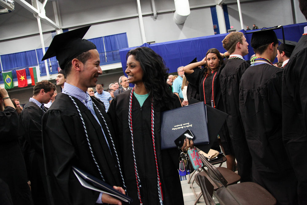 Following the Commencement ceremony, F&M's newest alumni were all smiles as they looked for their friends and family members in the audience at the Alumni Sports & Fitness Center. (Photo by Melissa Hess)