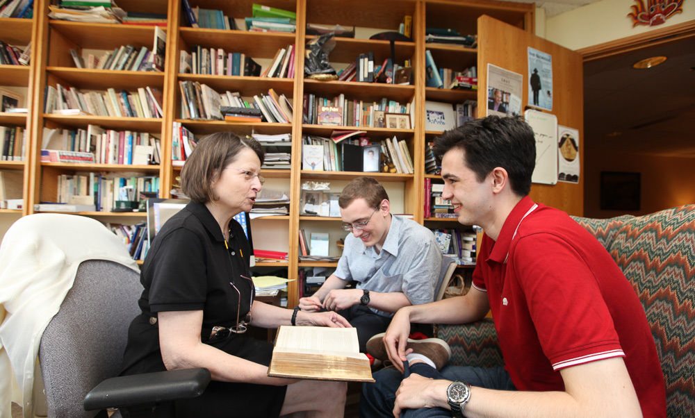 British exchange students John Scott Fitzpatrick (right) and Ian McEvatt, from the University of Chichester, work with their F&M academic adviser, Louise Stevenson, professor of history and American studies, on their dissertations. (Photo by Melissa Hess)