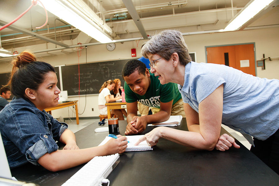 "F&M Professor of Physics and Astronomy Linda Fritz explains an energy experiment involving light bulbs and batteries to F&M College Prep students Ruth Betancourt (left) and Kevin Kelley during the ""What is Energy?"" class. (Photo by Melissa Hess)"