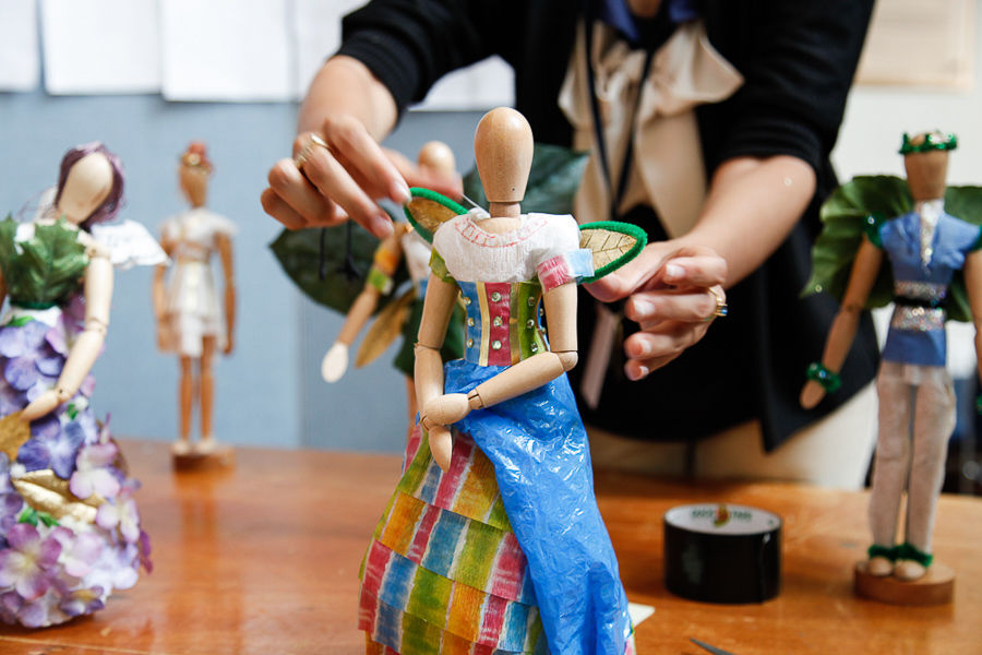 "Wooden dolls wear costumes designed and created by students in as part of F&M College Prep's ""Costume Design"" class. The dolls were on display during the project fair that capped the three-week program. (Photo by Melissa Hess)"