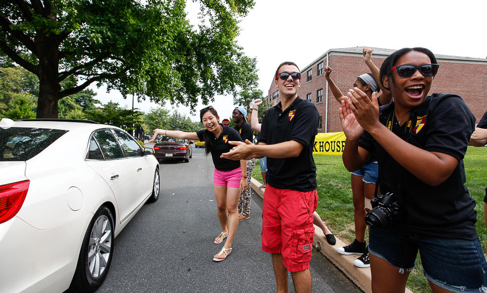 Upperclass members of Franklin & Marshall's Bonchek College House cheer as first-year students and their families arrive on campus on Move-In Day. (Photo by Melissa Hess)
