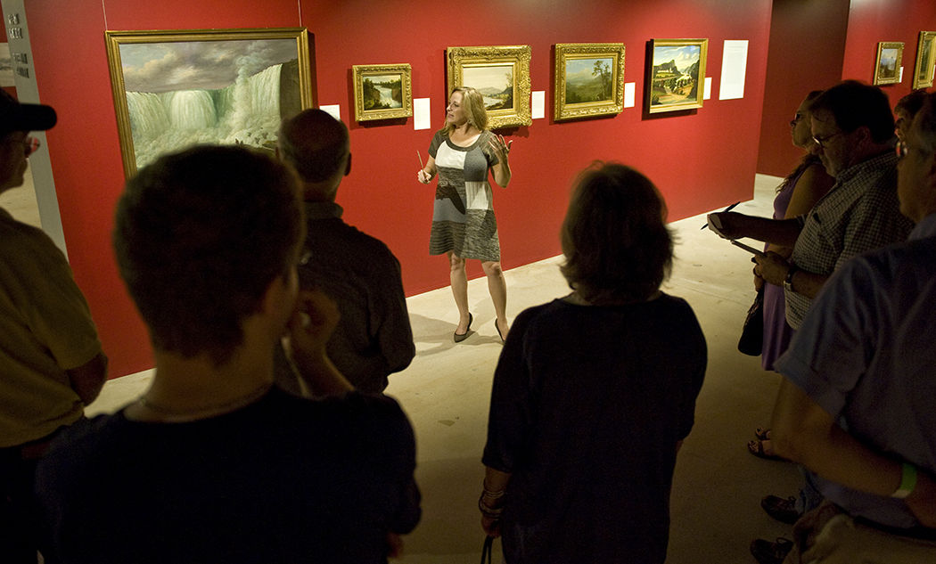 Nancy J. Siegel, Ph.D., '88, an associate professor of art history at Towson University, on Saturday guides a tour of an exhibit on display in the Phillips Museum of Art: a collection of Hudson River School paintings from the New-York Historical Society. (Photo by Eric Forberger)