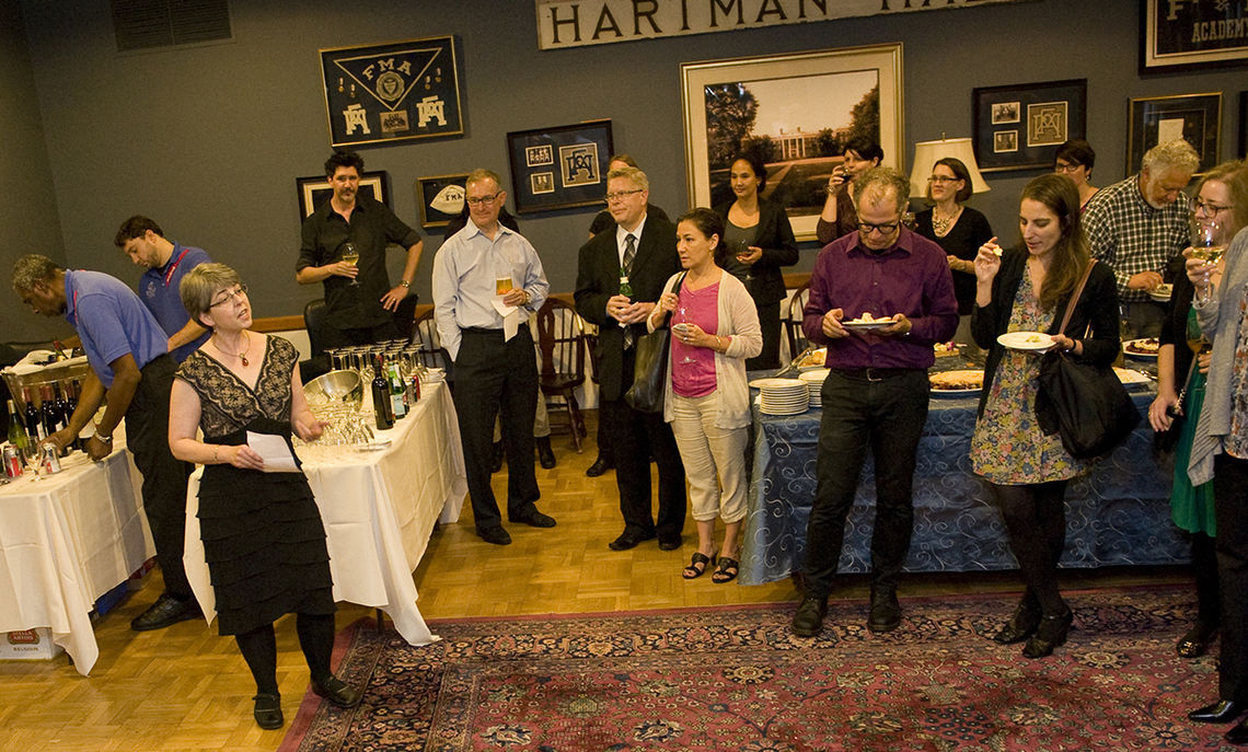 Mary Ann Levine, interim director of the Franklin & Marshall College Faculty Center, on Oct. 11 welcomes members of the F&M faculty to a reception marking the opening of the center. The reception was held in the Academy Room of the library. During the event, Levine gave tours of the center, which is on the second floor of the library, to smaller groups of faculty and professional staff. (Photo by Eric Forberger)