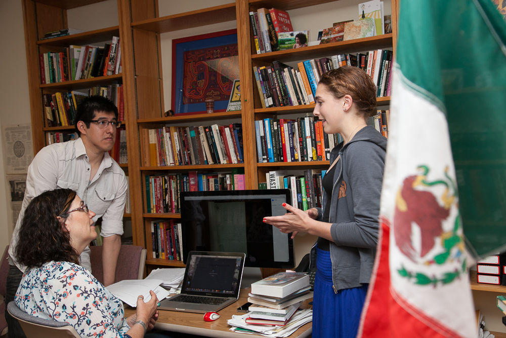 Franklin & Marshall College Assistant Professor of History Laura Shelton is collaborating with two student Hackman Scholars, Cesar Diego and Morgan Gray, on the cause behind an unsual number of infanticide cases in 19th century Mexico, part of a larger body of research on the roles of midwives. (Photo by Melissa Hess)