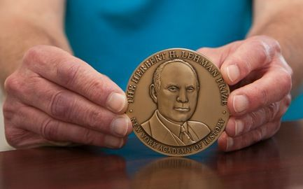 The medal given to recipients of the Herbert H. Lehman Prize for Distinguished Scholarship in New York. (Photo by Melissa Hess)