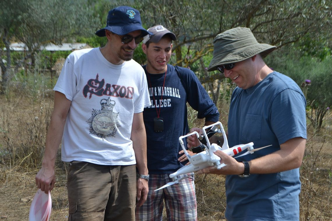 Franklin & Marshall College Hackman Scholar Joel Naiman working with Associate Professor of Art History Todd Brenningmeyer of Maryville University (right) and Niko-Paris Valdegar, an architect student at the National Technical University of Athens, on the drone they used to capture aerial photos of a village for the purpose of creating a map. (Photo Courtesy of F&M Assistant Professor of Art History Kostis Kourelis)